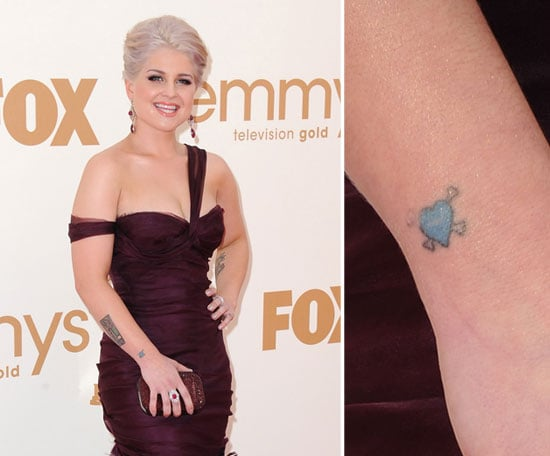 Kelly Osbourne has a tiny blue heart and crossbones tattoo on her right wrist.