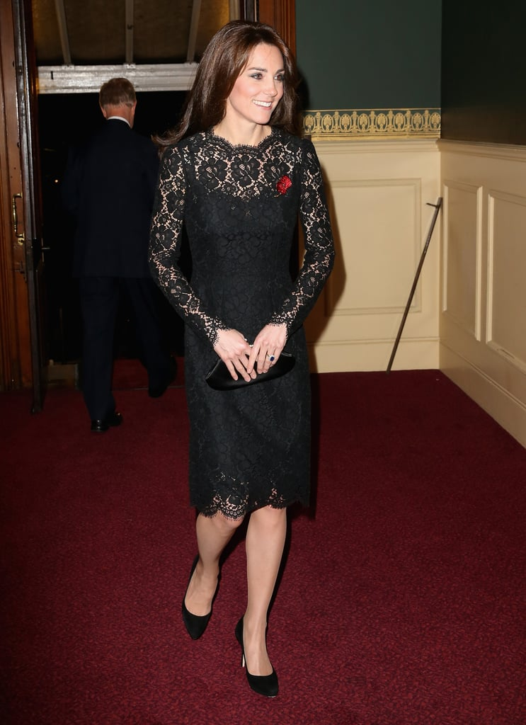 Kate completed her Dolce & Gabbana lace dress with a bright red poppy pin, an Anya Hindmarch clutch, and black pumps.
