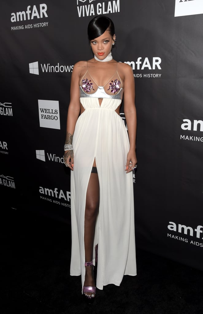 The amfAR Inspiration Gala took place at Milk Studios in LA on Wednesday night and while the event, which benefits AIDS research, brought out plenty of famous faces, it was hard to concentrate on anything beyond the serious amount of skin that was showing on the red carpet. Miley Cyrus chose a daring black look while Rihanna showed a similar amount of cleavage in a jewelled gown that barely covered her chest. Michelle Rodriguez, Natasha Bedingfield, and Lea Michele also wore low-cut looks for the cameras. Alessandra Ambrosio went sheer for her ensemble, whereas pregnant stars Molly Sims and Milla Jovovich stuck with more covered-up dresses. Keep reading to see more from the philanthropic night, which honoured Tom Ford and also brought out Eddie Redmayne, Kelly Osbourne, and Dita Von Teese, among others.