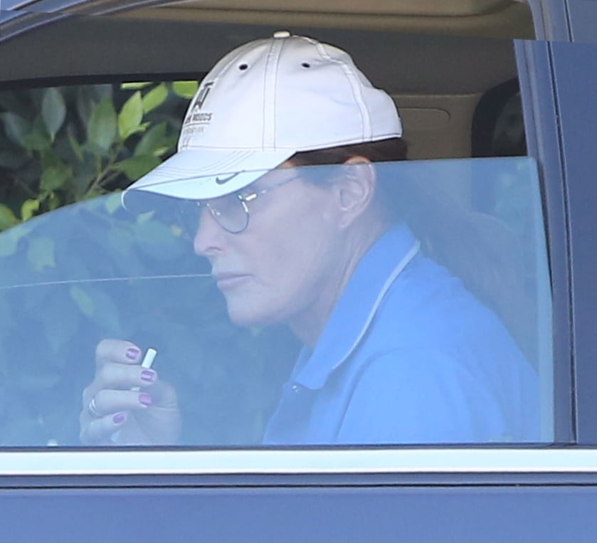 """Bruce Jenner celebrated his 65th birthday on Tuesday with a bright red manicure and a cigarette. The former Olympian rocked his new painted nails while driving around Malibu, CA, in his Escalade. Bruce's evolving look has been getting quite a bit of attention in the press, particularly after he announced his separation from Kris Jenner. He recently grew out his shaggy hairstyle into a long bob and underwent a controversial """"tracheal shave"""" back in January to reduce the size of his Adam's apple. His new look led to rumors that he was planning on transitioning from male to female, which has been repeatedly shot down by his friends and family as """"absurd."""" After all, Bruce is hardly the first male star to get a manicure!"""