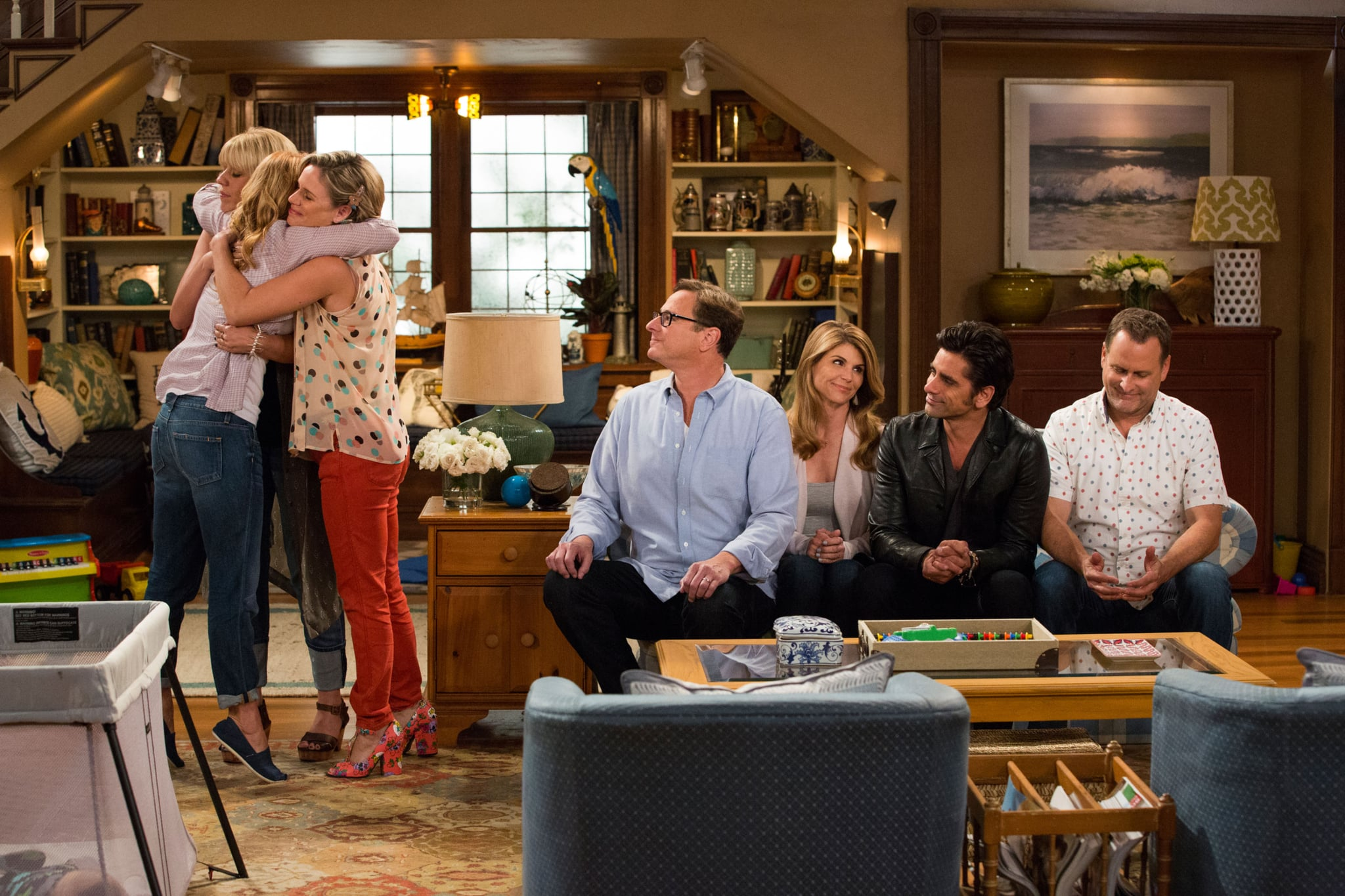 FULLER HOUSE, l-r: Jodie Sweetin, Candace Cameron Bure (back to camera), Andrea Barber, Bob Saget, Lori Loughlin, John Stamos, Dave Coulier in 'Our Very First Show, Again' (Season 1, Episode 1, aired February 26, 2016). ph: Michael Yarish/Netflix/courtesy Everett Collection