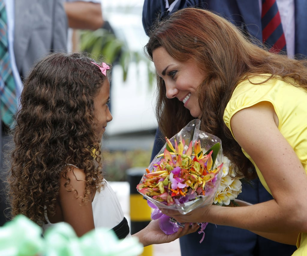 Kate received flowers from a sweet little girl during her visit to the Solomon Islands in September 2012.