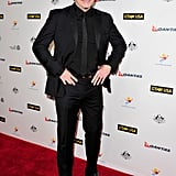 John Travolta made a rare red carpet appearance at the party.