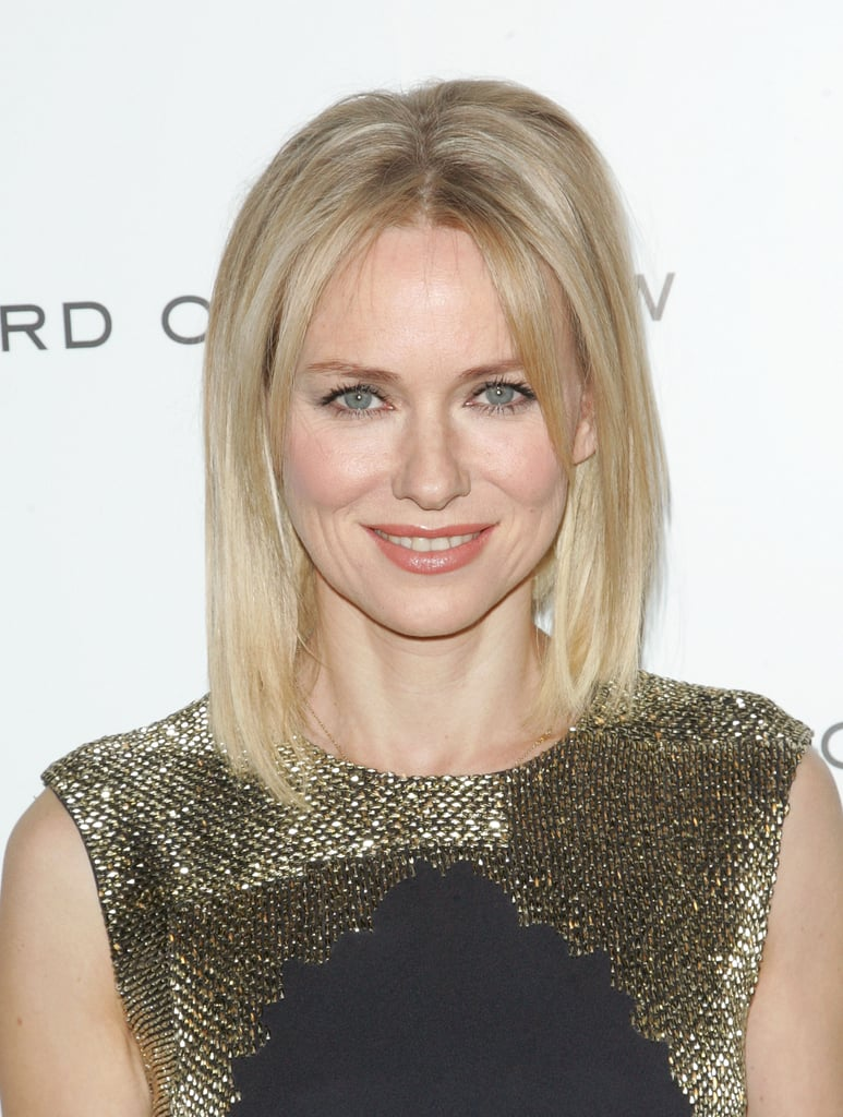 Naomi Watts glittered in a gold dress.