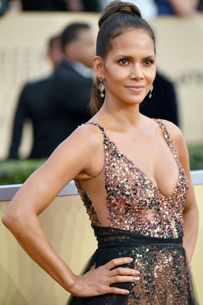 When Halle Berry arrived at Sunday night's Screen Actors Guild Awards, we were in awe of her gorgeous sectioned ponytail, but the second she turned around and we saw her shaved hairdo, that's when the whole look came together. Although the 51-year-old actress debuted this shaved section at the end of last year, she took her edginess and badass style to the next level on the red carpet when she glammed up the ponytail to flaunt the back of her head. We're just wondering why she's trying to grow it out?  Halle's sectioned ponytail was wrapped with her own hair, styled in loose beach waves. After decades of wowing on the red carpet, she never ceases to amaze us. Halle rocked natural makeup with a nude pink lip and matching eye shadow complementing her dress and, um, that banging mom body. Read on to see photos of Halle's stunning red carpet look.      Related:                                                                                                           Halle Berry Is Aging Backward, and It Needs to Be Discussed