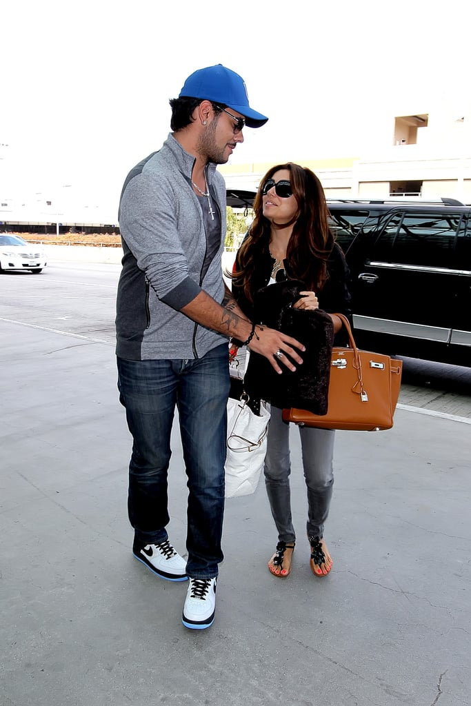 """Eva Longoria and Eduardo Cruz stuck together yesterday when they arrived at LAX. The couple headed out of town during a break in work for Eva, who is on hiatus from shooting Desperate Housewives. She's been busy with her philanthropy, having visited sick children at the LA's Children's Hospital and participating in a shoot for Toys R Us's """"Toy Guide For Differently Abled Kids"""" this week alone. Eva is still doing press for her cookbook, Eva's Kitchen and traveled to her home state of Texas recently for a signing. She and Eduardo love to fit in getaways when they can, and they went to Miami for a bikini- and shirtless-filled excursion just last month. That trip came after a stint in Mexico, where Eva and Eduardo showed PDA during April."""
