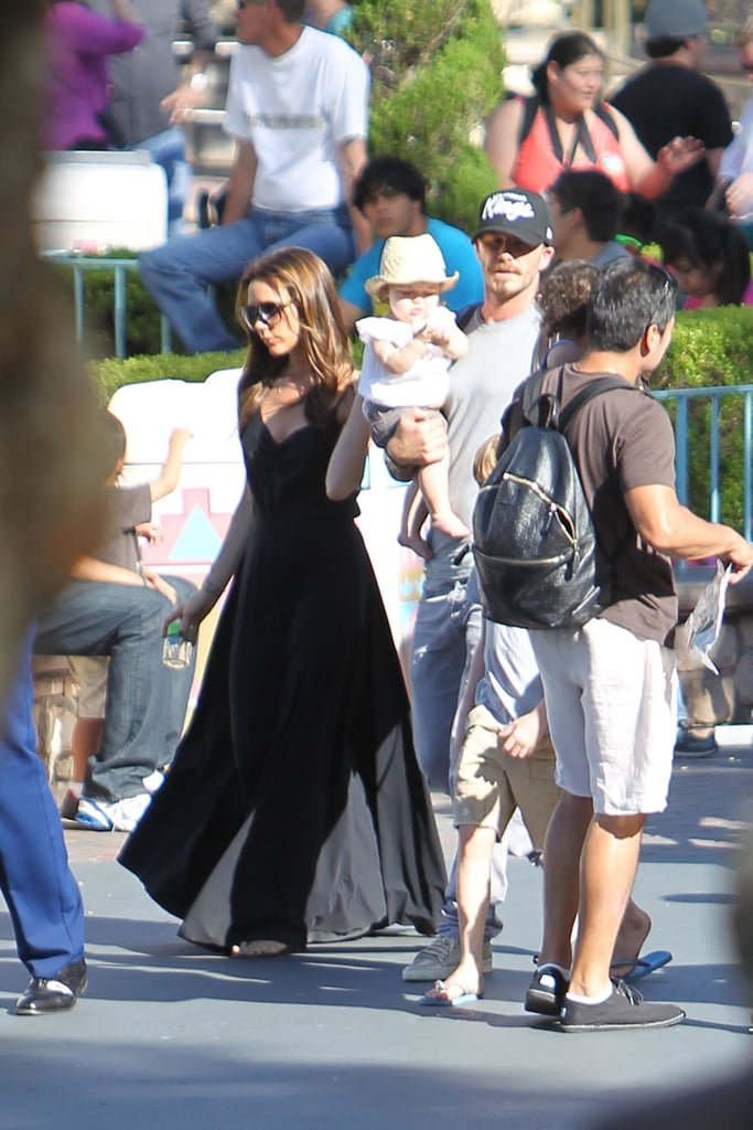 Victoria Beckham and David Beckham carried Harper around Disneyland.