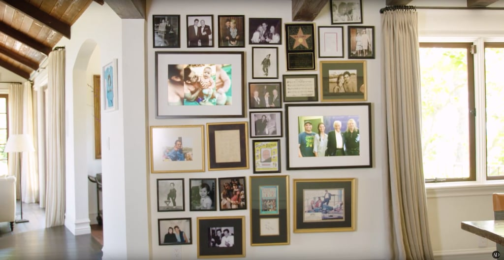 The main room has a wall that's positively plastered with family photos and snaps of John with other famous faces.