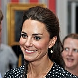 Duchess of Cambridge Catherine smiled during conversation.