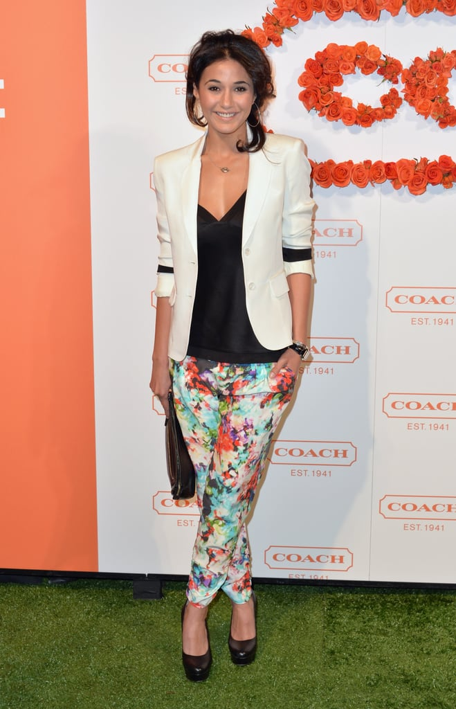 Floral-print trousers, like these on Emmanuelle Chriqui, are a polished way to add some Summer fun to your work look. Pair 'em with muted colors like black and white for office-appropriate style.