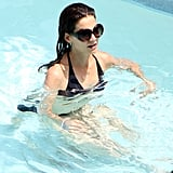 Katie Holmes goes for a swim in her bikini.