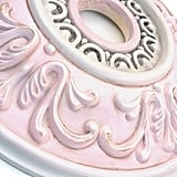For a shabby-chic nursery, this beachy pink medallion ($70) will complete your space. Since this product is made to order, you can customize color, making it fitting for a baby boy, as well.