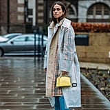A see-through trench will keep you dry and still lets you show off your outfit.