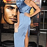 Rosario Dawson's blue Stella McCartney dress, nude Brian Atwood pumps, and Jimmy Choo clutch mesh beautifully together.