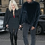 When Kim's ensemble consisted of thigh-high boots and Givenchy pinstripes, but Kanye was still all about that velour pullover.