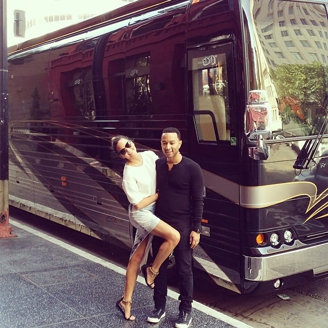 Chrissy Teigen cozied up with her husband, John Legend, in front of his tour bus. Source: Instagram user chrissyteigen