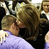 Before she left the race, Michele Bachmann kisses a volunteer in Iowa.