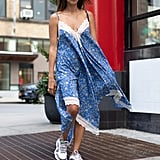 A slip dress with sneakers is so much more than a slip dress.