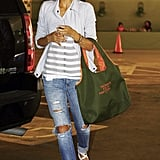 Jessica Alba returned to her car after shopping in Westwood in a pair of torn jeans, striped tank, and strappy white sandals. She also brought along a souvenir from the Tribeca Film Festival.