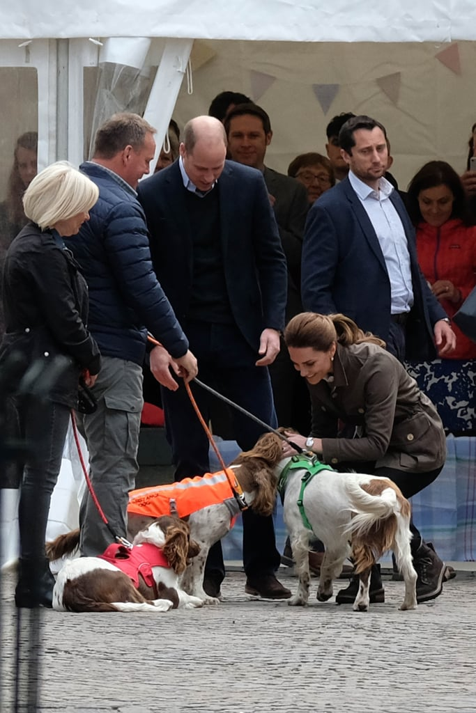 "Prince William and Kate Middleton got back to royal duties as they visited Cumbria, England, on Tuesday morning, following the fun celebrations of the Queen's birthday on Saturday at the annual Trooping the Colour.  The reason for the visit was to ""celebrate the work of local heroes, farmers, volunteers and those supporting the rural community in Cumbria."" The duke and duchess started their day trip in Keswick where Kate cuddled with not one, not two, but three adorable dogs. Opting for comfort, the duchess chose to wear her trusty black skinny jeans, countryside jacket, and Chloe boots for the occasion. Her and William also did some browsing on market stalls, we wonder whether they bought anything? As always, Kate made sure to chat to the locals, bending down to mingle with the kids, too. She was also gifted some flowers, which she looked genuinely touched to receive. The couple finished their trip with a visit to a local farm where Kate tried a bit of sheep shearing as well as taking part in the repair of a dry stone wall, which Kate naturally made look like the most fun ever.  Keep reading to see all the photos from Kate and William's day trip."