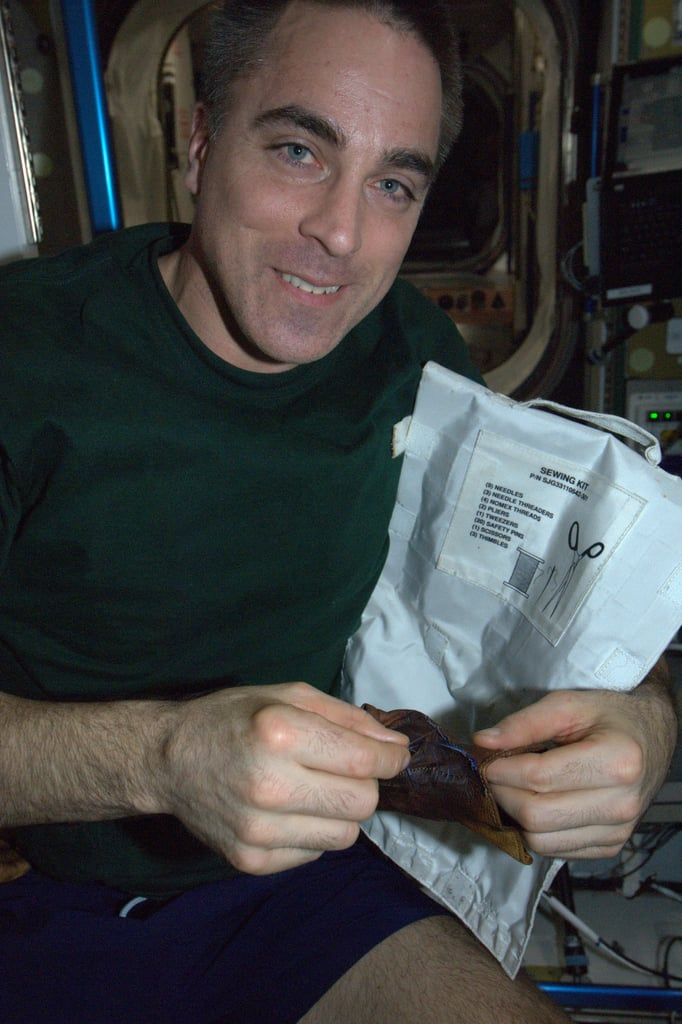 """Sewing — an important expeditionary skill! My crewmate Chris Cassidy mends a weightlifting glove (no running to the store for new ones) that should now last until he leaves the Space Station in September. KN from space.""  Source: Pinterest user Karen Nyberg"