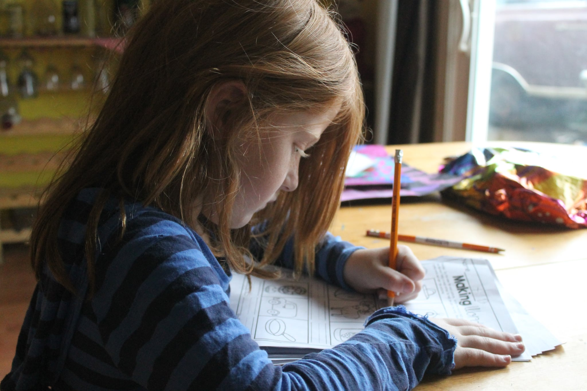 tmp_L4ZJ8k_c523a1f1f8908421_child-girl-homework-1001675.jpg