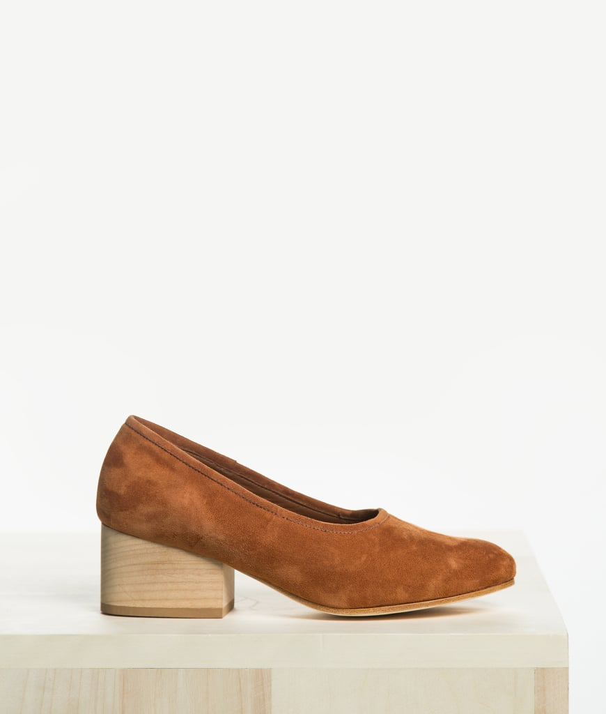 """""""The wooden block heel and cognac suede color of these Ceri Hoover Gabriella Pumps ($295) makes them timeless. I can see them jazzing up a casual party look, but I know I'll wear them into Spring, too, with paisley-print maxi dresses."""" — SW"""