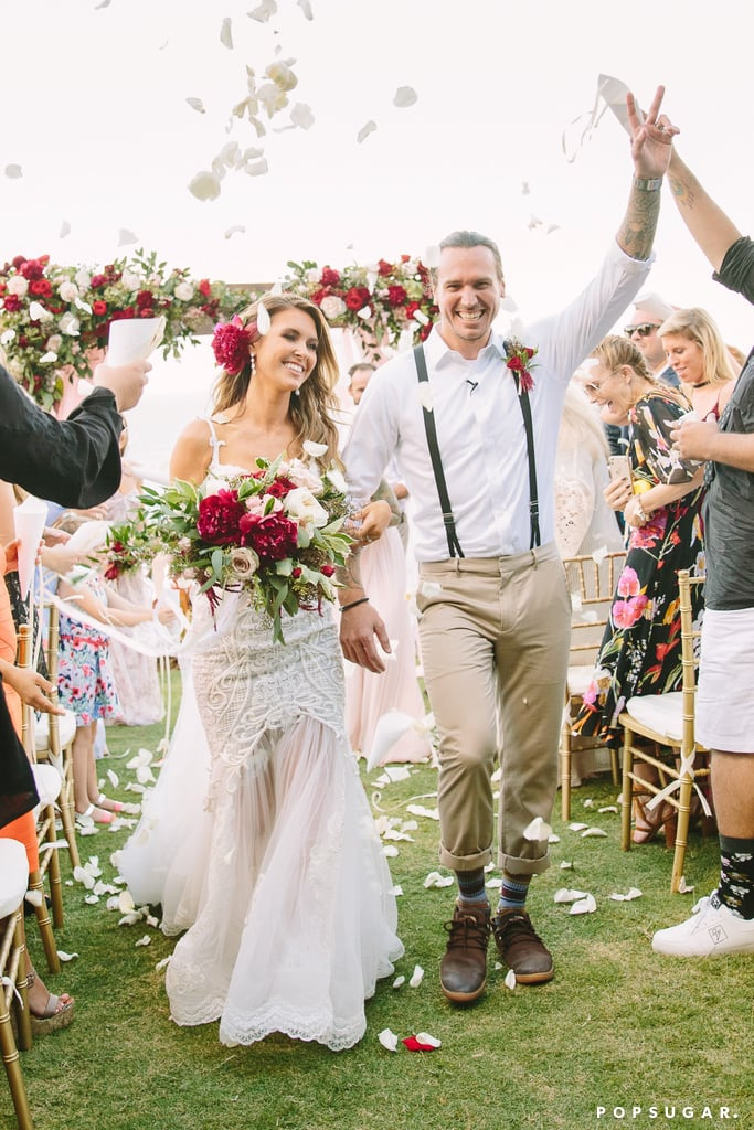 Audrina Patridge and BMX rider Corey Bohan tied the knot in a stunning beach wedding in Hawaii on Saturday. The former star of The Hills looked gorgeous in a Pallas Couture gown while her groom sported a white button-down and suspenders. They were wed at a botanical garden overlooking the ocean in front of 100 of their closest friends and family members. The couple's daughter Kirra, who was born in June, also played a part in the ceremony; the little one wore a white dress and matching headband as Audrina and Corey held her at the altar. Corey and Audrina dated on and off since 2008, and got engaged back in November 2015.       Related:                                                                                                           Laguna Beach and The Hills: Where Are They Now?