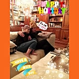 Kelly Osbourne cuddled with her dad, Ozzy, while waiting on Thanksgiving dinner.