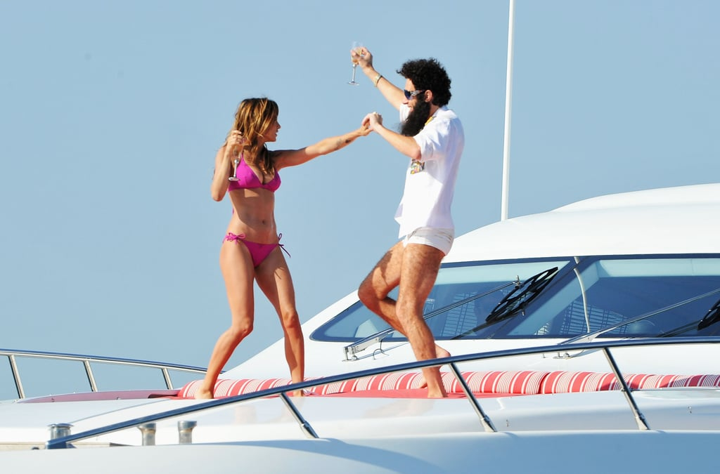 Sacha Baron Cohen and Elisabetta Canalis danced on a luxury yacht for The Dictator at the Cannes Film Festival.