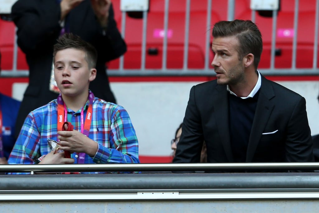 David and Brooklyn Beckham watched Sunday as Great Britain played the United Arab Emirates in an Olympics soccer match.
