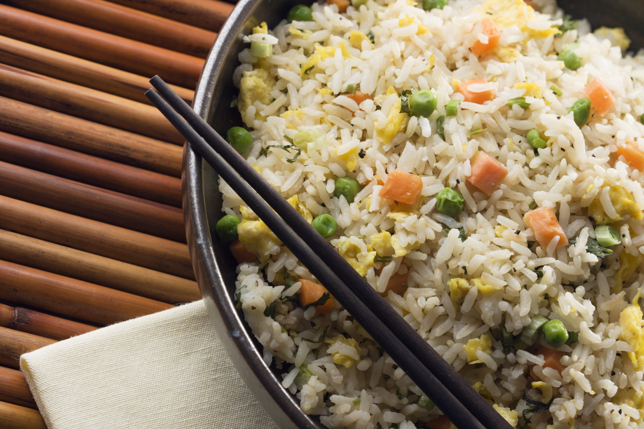 Subject: Traditional authentic Chinese Fried rice served in a bowl.