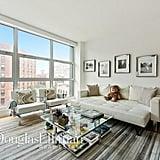 Gigi's living room has a view of the city.