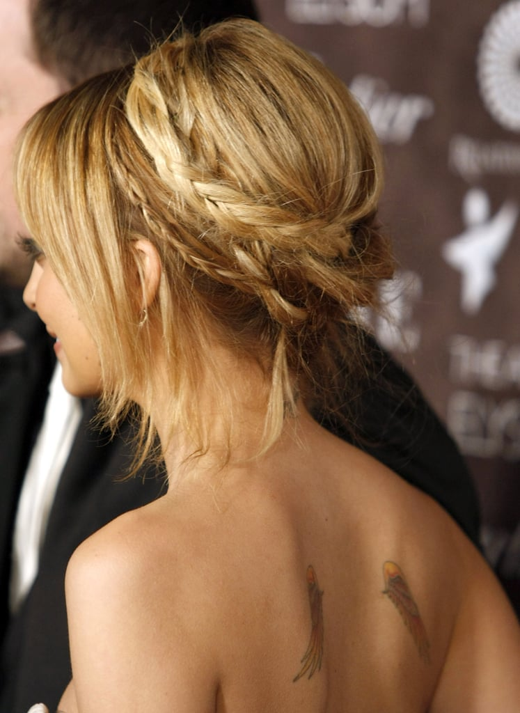 Nicole Richie's series of braids coil together into a pretty crown, creating a fun twist on a standard look.