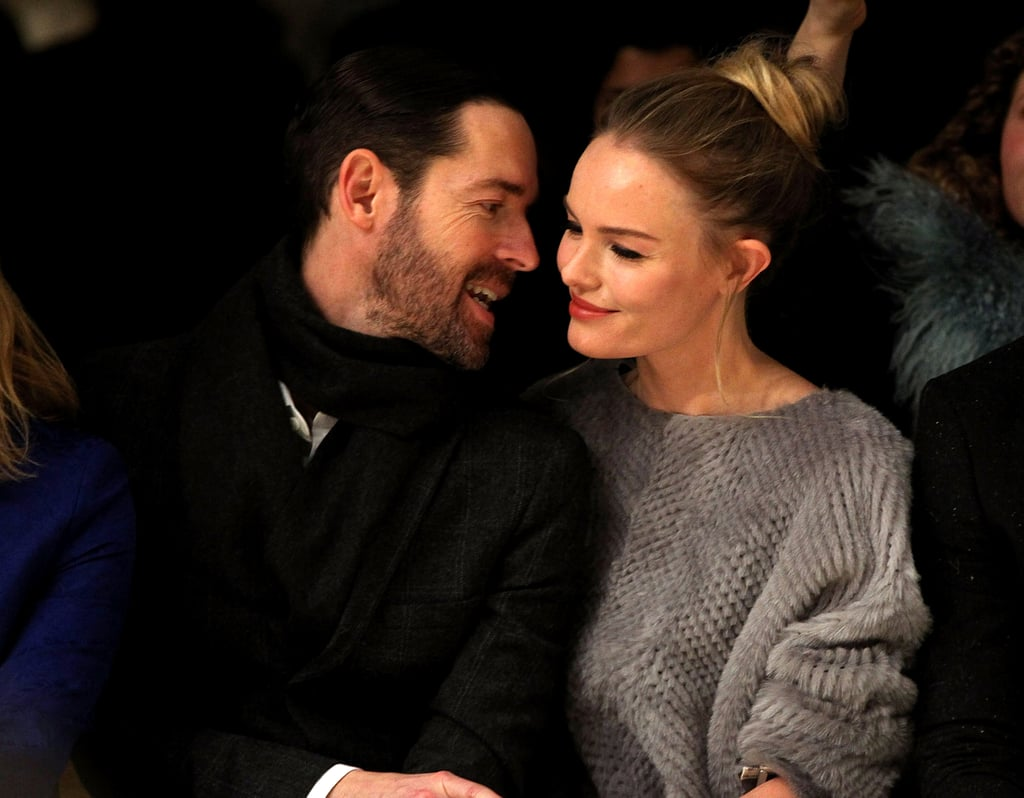 Kate Bosworth and fiancé Michael Polish cozied up to each other in the front row of Topshop's London show.