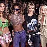 Victoria Beckham and Melanie Brown showed off their abs while Melanie Chisholm and Emma Bunton opted for slightly more covered-up looks in London in 2002.