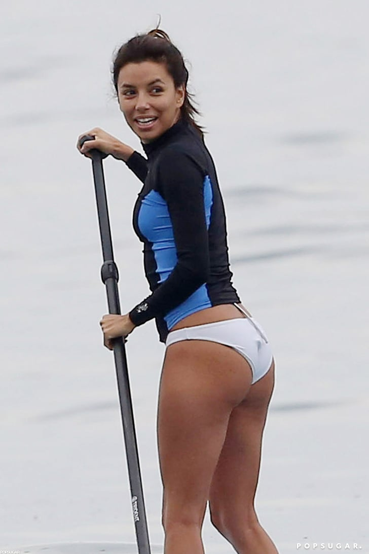 Eva Longoria sported white bikini bottoms as she kept her balance on a paddleboard.