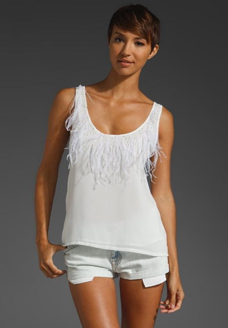 Throw this tank on with a pair of black skinnies for a night out.  T-Bags LosAngeles Feather Tank ($215)