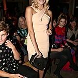 Pixie Lott went nude with black accessories at Moschino Cheap & Chic.