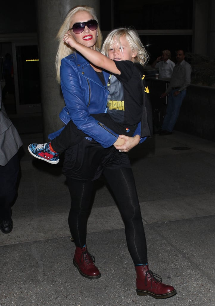Gwen Stefani carried her son Zuma, who showed off his superhero style in a Batman cape, as they touched down at LAX on Saturday. Gwen and her youngest returned home from their stay in London, where she promoted her newly released album, Push and Shove, with her No Doubt bandmates. She was busy with her press schedule, but Gwen snuck in quality time with Zuma while across the pond. The UK stop was one of No Doubt's final in an overseas tour, with Gwen and the band performing on The Jonathan Ross Show's latest episode.