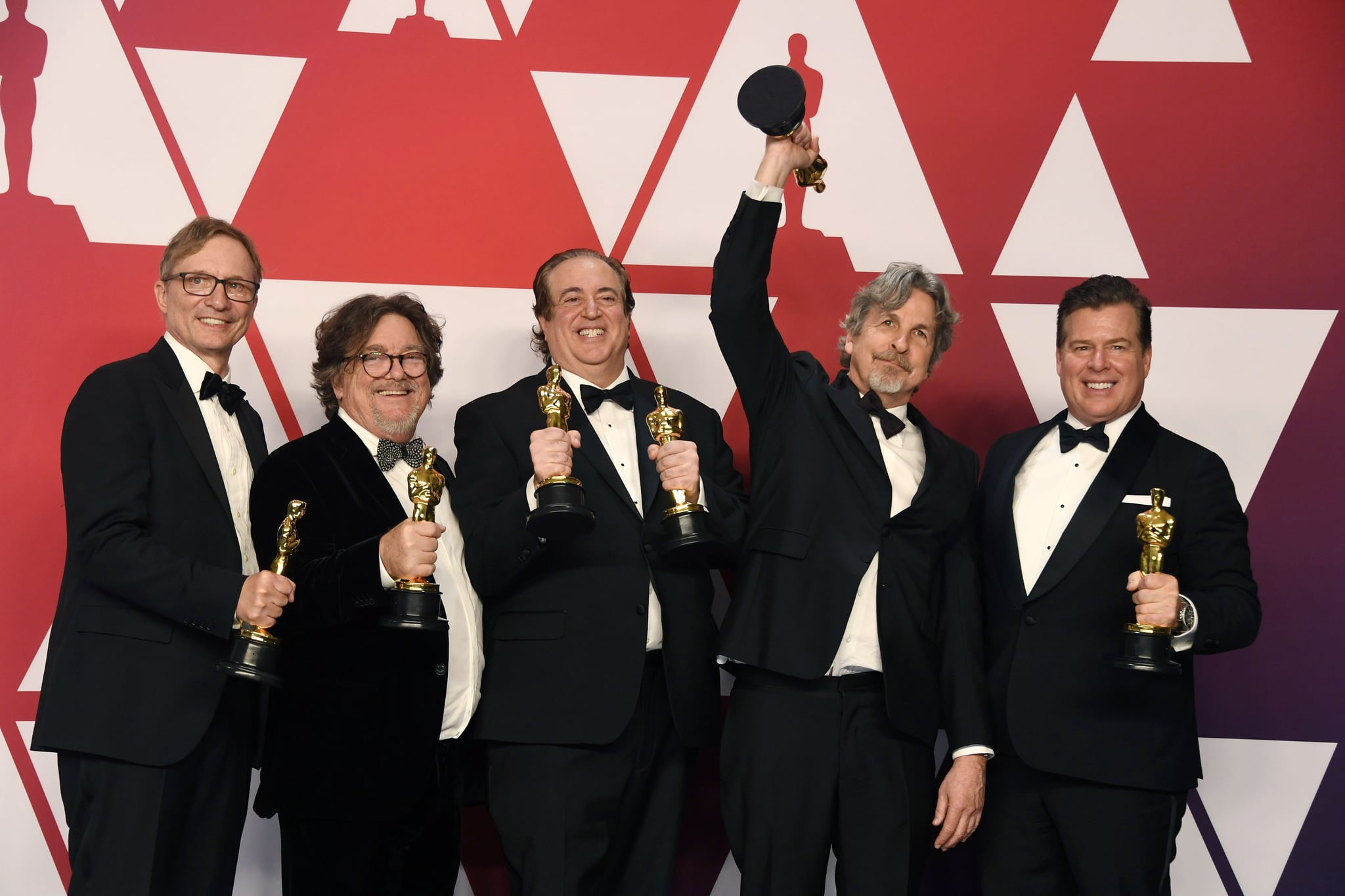 HOLLYWOOD, CALIFORNIA - FEBRUARY 24: (L-R) Jim Burke, Charles B. Wessler, Nick Vallelonga, Peter Farrelly, and Brian Currie, winners of Best Picture for