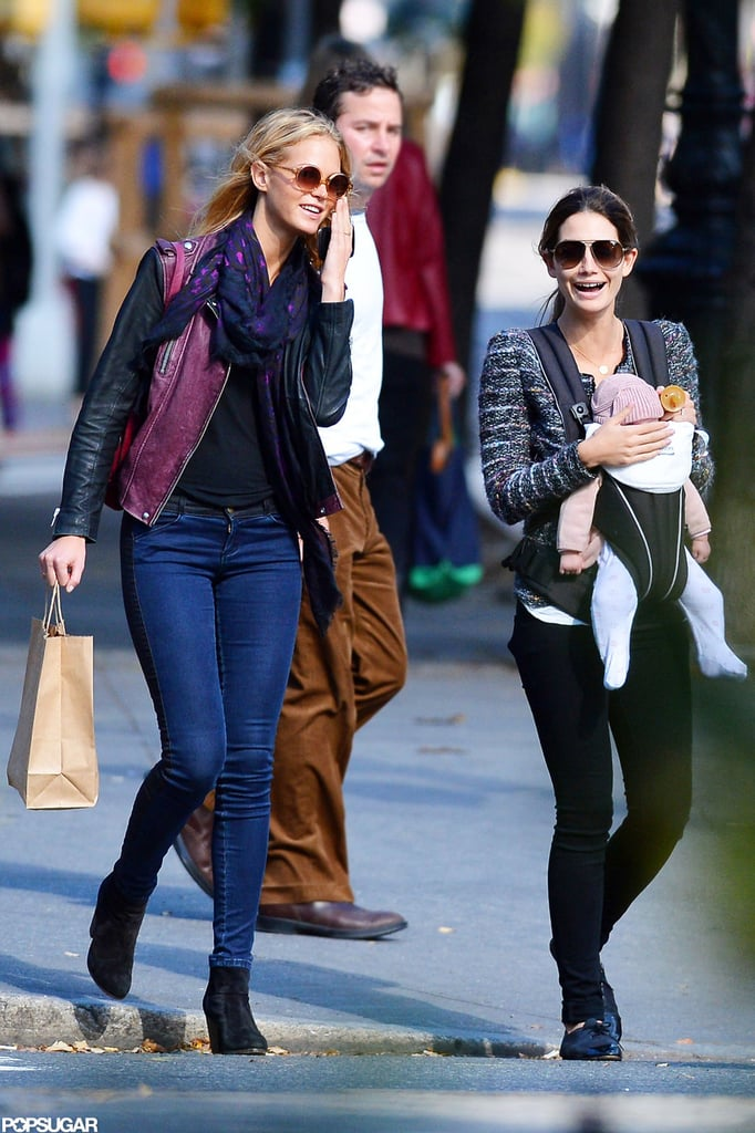 Lily Aldridge and Erin Heatherton laughed together on the street.