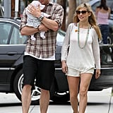 Chris Hemsworth held tight to two-month-old daughter India during a stroll in Santa Barbara with his wife Elsa Pataky on July 21.