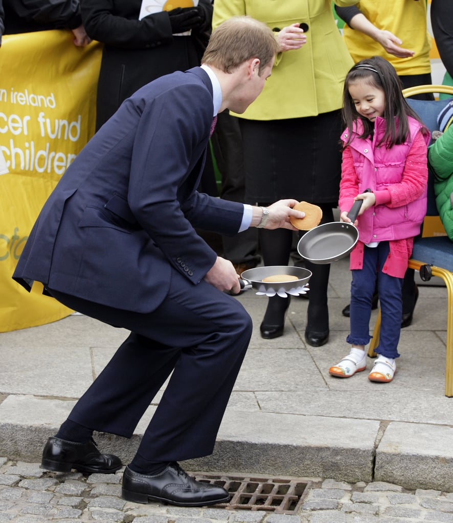 "How's this for adorable? During a ""pancake tossing"" event at Belfast City Hall in March 2011, a little girl dropped hers — and William cutely picked it up for her."