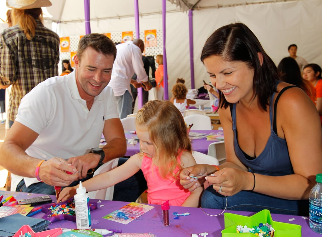 Scott Foley and wife Marika Dominczyk helped their daughter, Marley, decorate a colorful art project at a June 2012 charity event in LA.