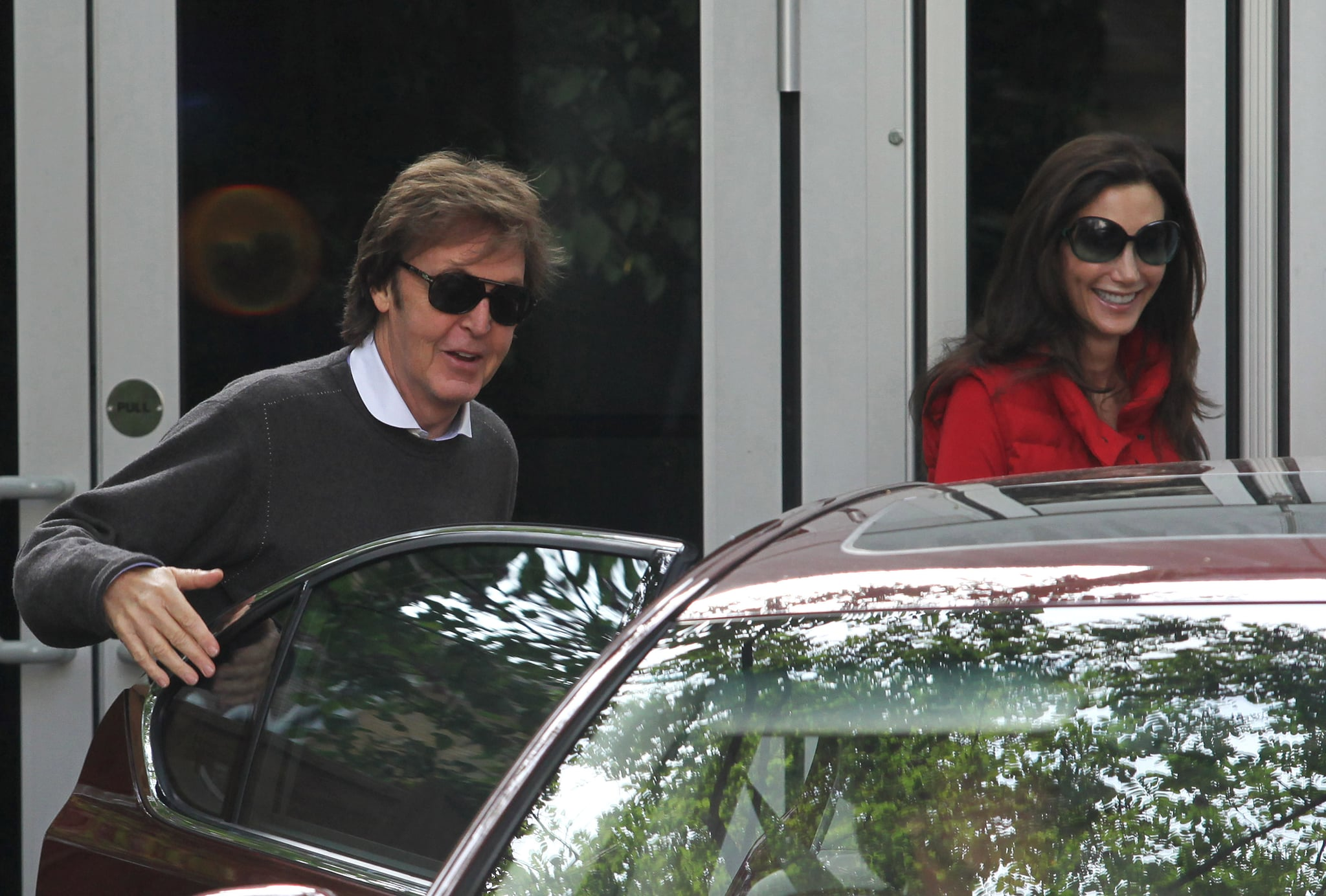 Paul McCartney hops into his car with wife Nancy Shevell.