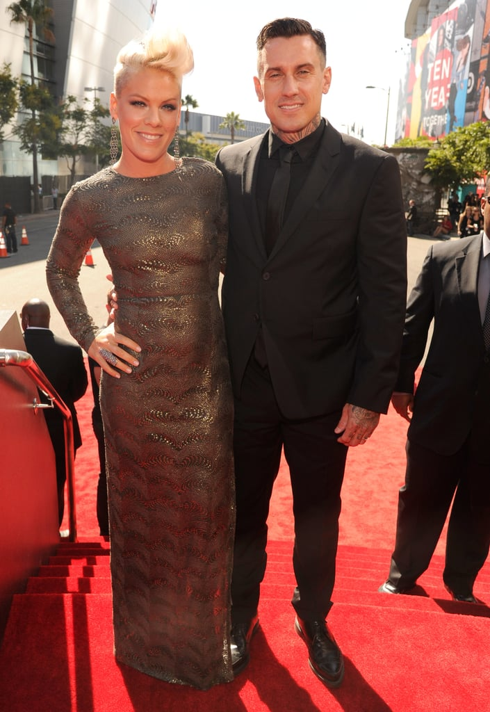 """Pink and her husband, Carey Hart, arrived at the MTV VMAs in LA this afternoon. They were side by side as they walked the red carpet and even kissed for the cameras on their way in to the Staples Center. Pink wore a sexy, long-sleeve Stella McCartney gown for the award show, where she'll be performing """"Blow Me (One Last Kiss)."""" She attended rehearsals over the weekend but was back to Mom duty just yesterday when Pink took her daughter, Willow, to the beach for a sunny outing."""