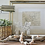 A DIY wood garland is rustic and very versatile. It looks stylish whether you string it from a mantel or incorporate it into a tabletop vignette.