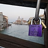 Love padlocks were clustered together on a railing on Ponte dell'Accademia in Venice, Italy.