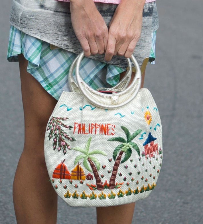 A quirky woven clutch set this look apart.  Source: IMAXtree